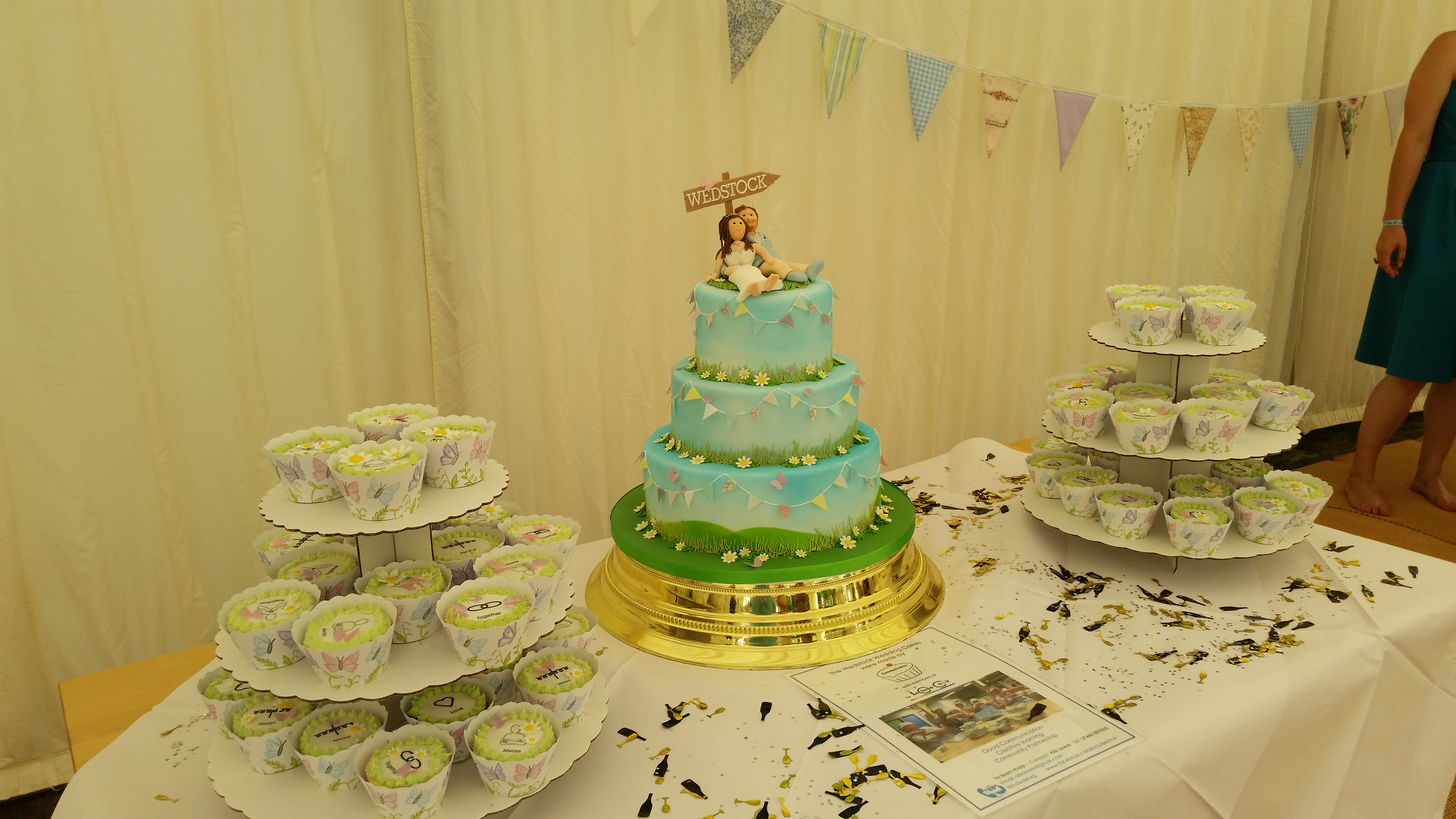 Completed wedding cake and cupcakes from Wedstock